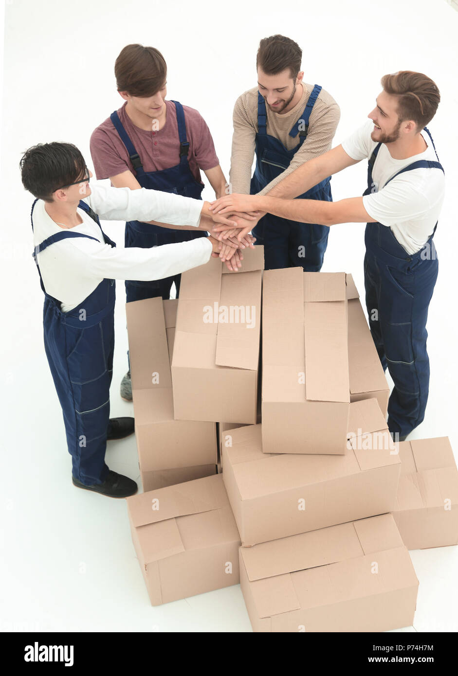Happy smiling movers carrying boxes, isolated on white backgroun - Stock Image