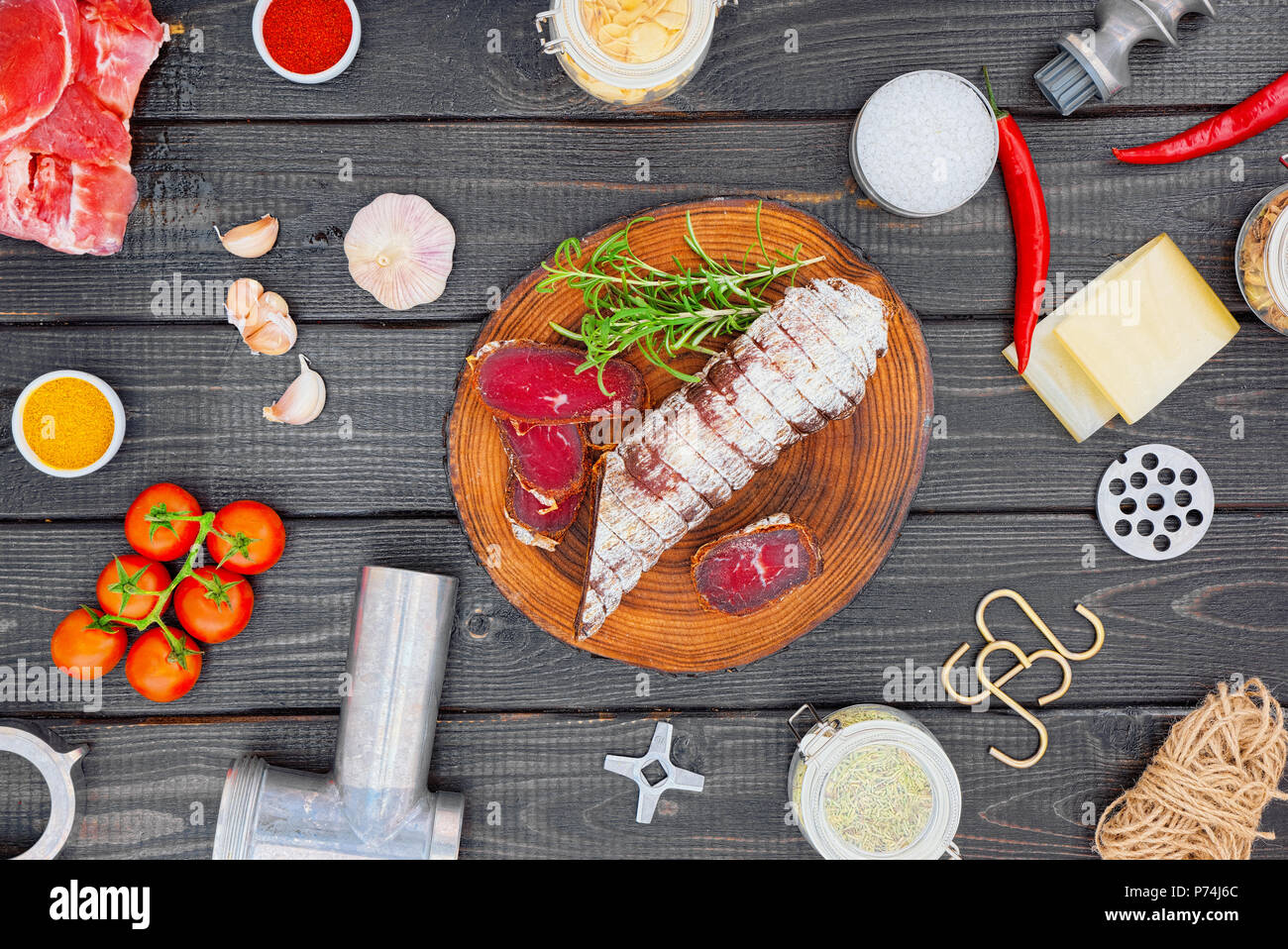 Ingredients of the production of cured sausage from the raw material to the finished product. - Stock Image