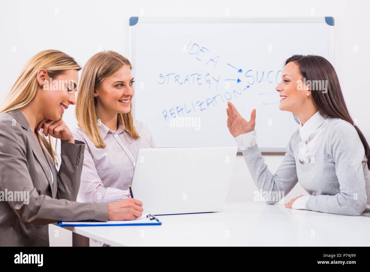 Young woman is having job interview. - Stock Image