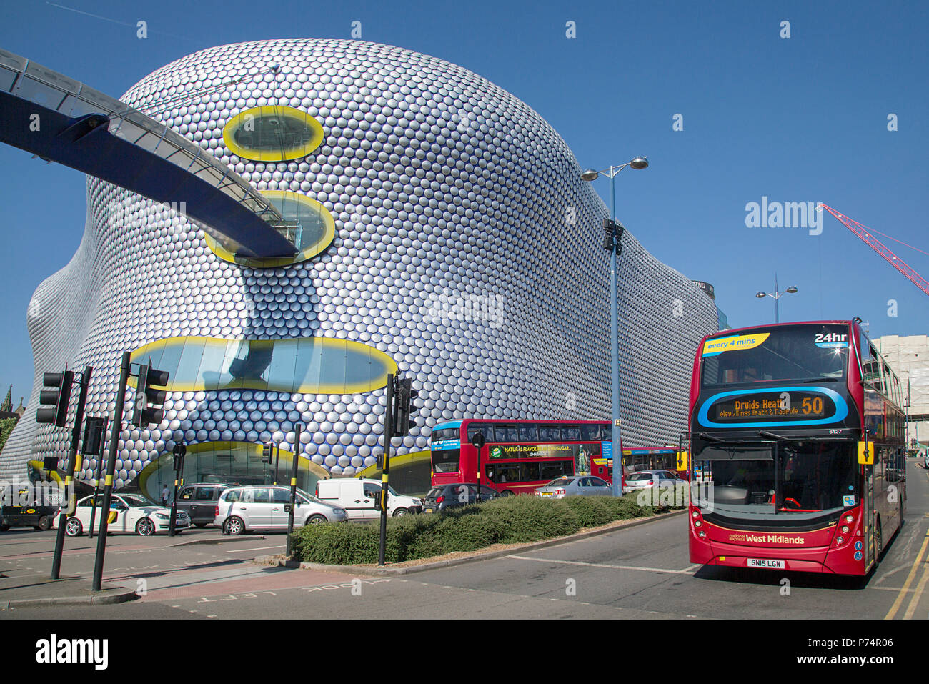 Birmingham, UK: June 29, 2018: Selfridges Department Store in Park Street part of the Bullring Shopping Centre. A bus is stopped at a traffic light. - Stock Image