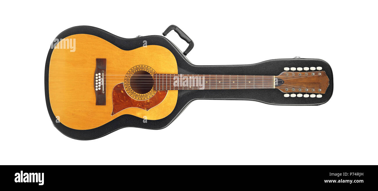 Musical instrument - Vintage twelve-string acoustic guitar from above on a hard case hard case on a white background. Stock Photo