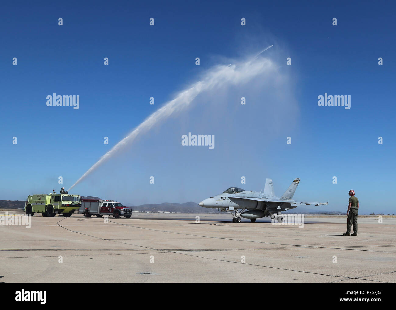 Maj. Gen. Mark R. Wise, the commanding general for 3rd Marine Aircraft Wing, is sprayed with water to celebrate his return from his final flight in an F/A-18C Hornet at Marine Corps Air Station Miramar, San Diego, Calif., July 02. Maj. Gen. Wise flew for the last time as the commanding general of 3rd MAW. (U.S. Marine Corps Photo by Cpl. Joshua S. McAlpine/Released) Stock Photo