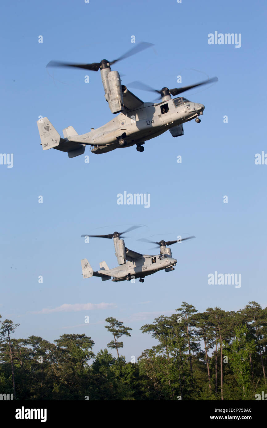 MV-22 Ospreys takeoff after picking up U.S. Marines with Battalion landing Team, 1st Battalion, 2nd Marines, 22nd Marine Expeditionary Unit during an Aviation Raid Course at Camp Lejeune, N.C., June 27, 2018. This course provides individual, small unit, and company level training to raid-force personnel on skills associated with aviation raids. (U.S. Marine Corps photo by Lance Cpl. Tawanya Norwood) Stock Photo