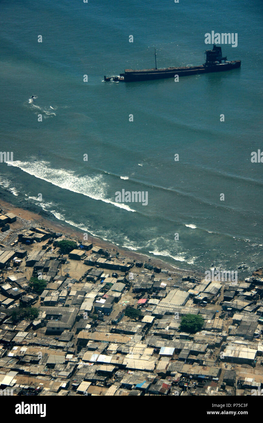 Aerial View of a Ship Wreckage off the Shore of Ghana - Stock Image