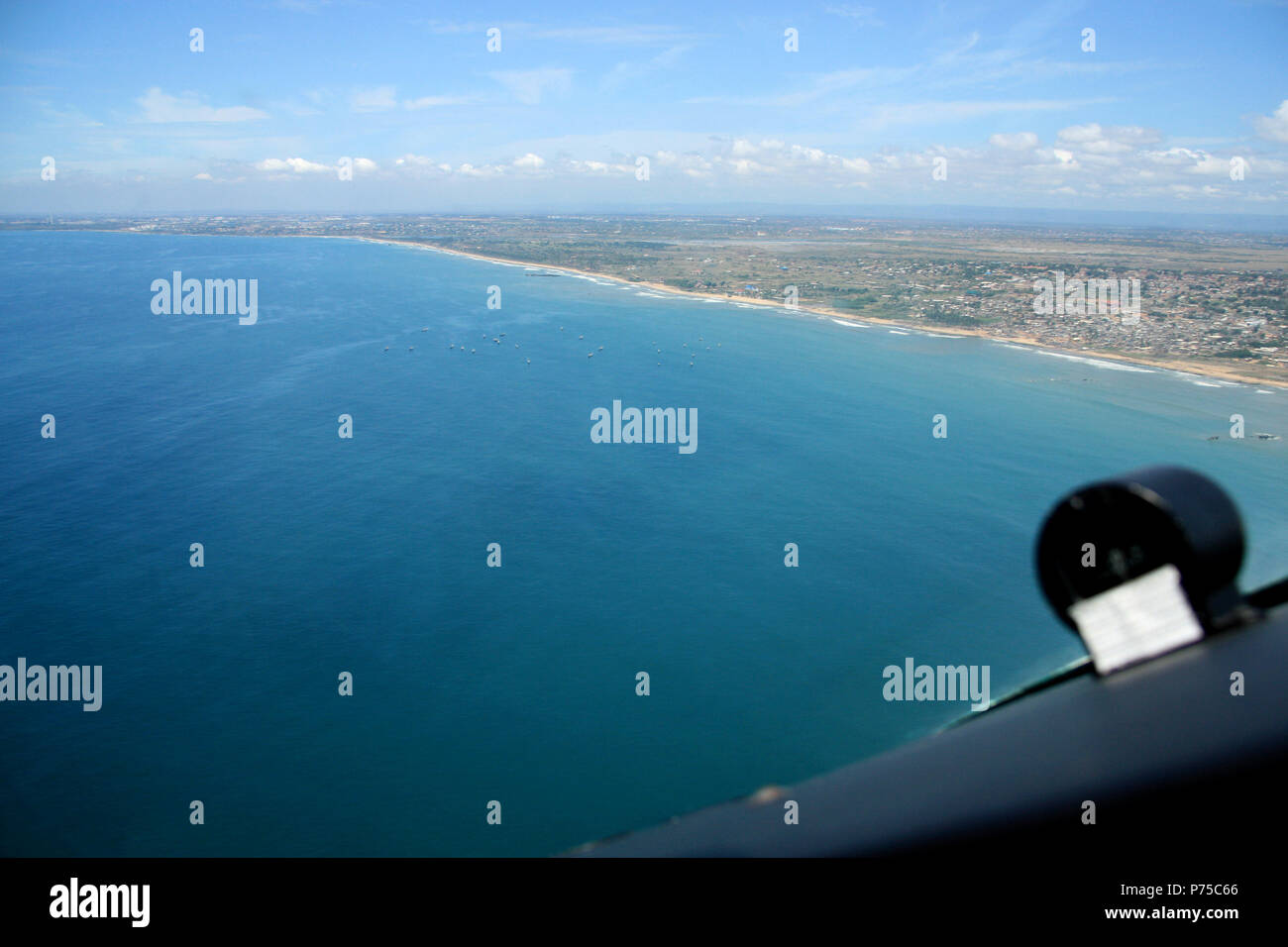 Fishing Boats off the Shore of Ghana, as seen from the cockpit of an airplane - Stock Image