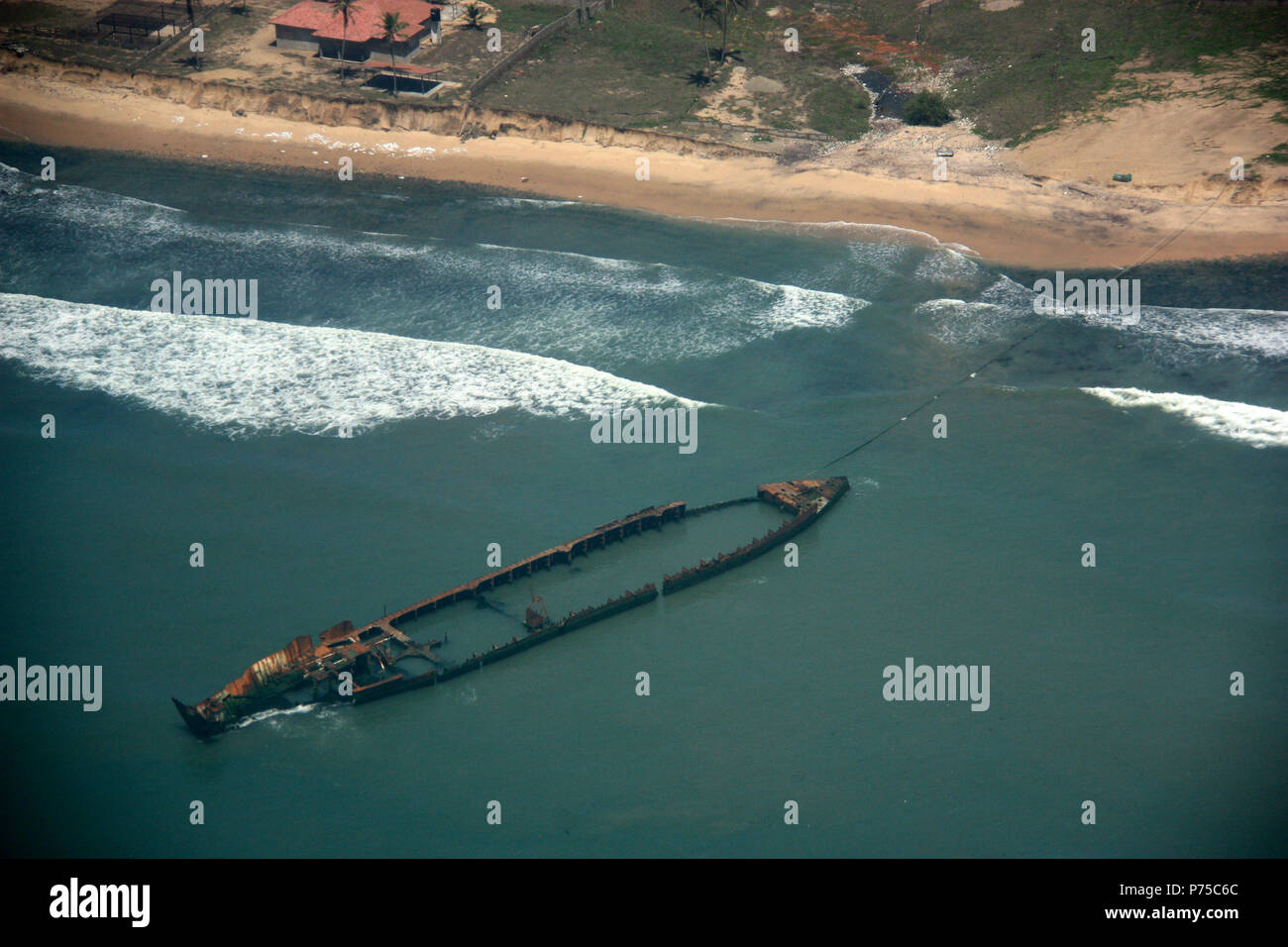 Aerial View of a rusty Ship Wreckage off the Shore of Ghana - Stock Image
