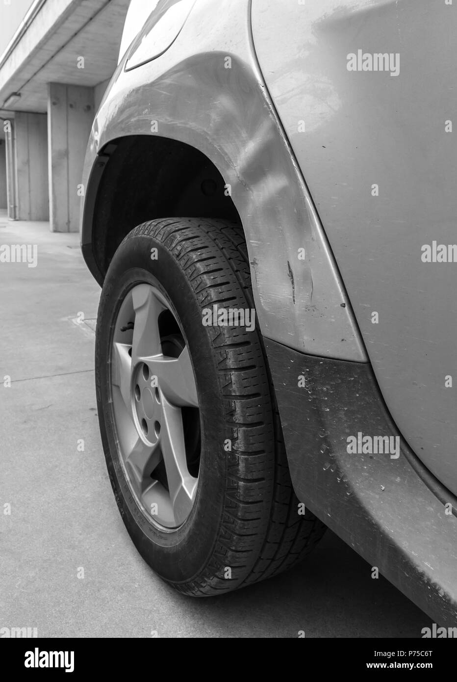 Dents on the car caused by the accident. Close-up. Stock Photo