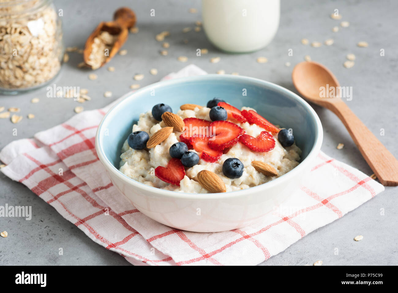 Oatmeal Porridge With Strawberries Blueberries And Almonds In A