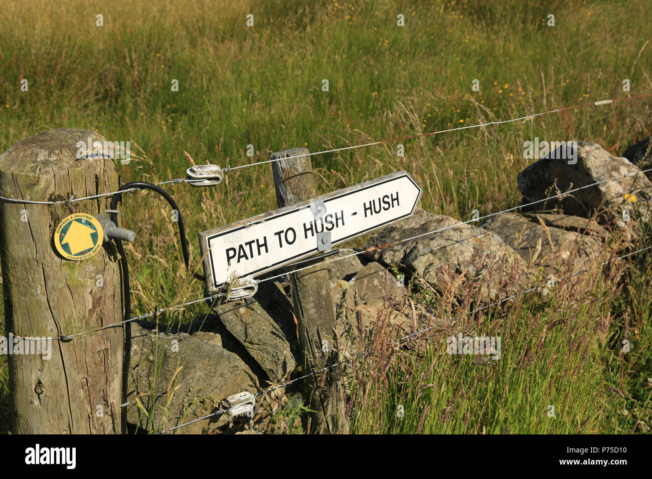 A sign showing the way to Hush - hush in Scotland, UK. - Stock Image