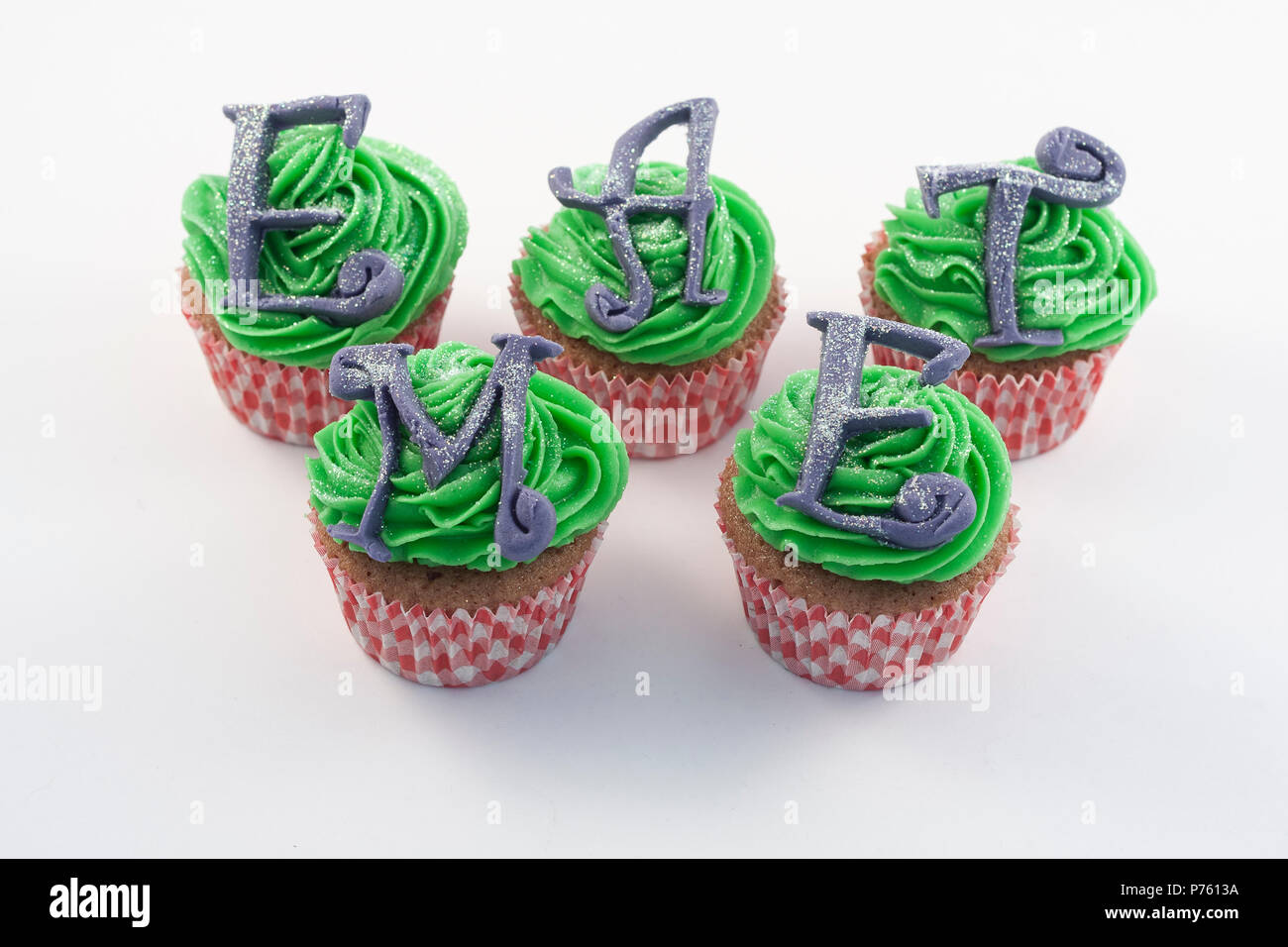 Several Cupcake decorated with alice in wonderland - Stock Image