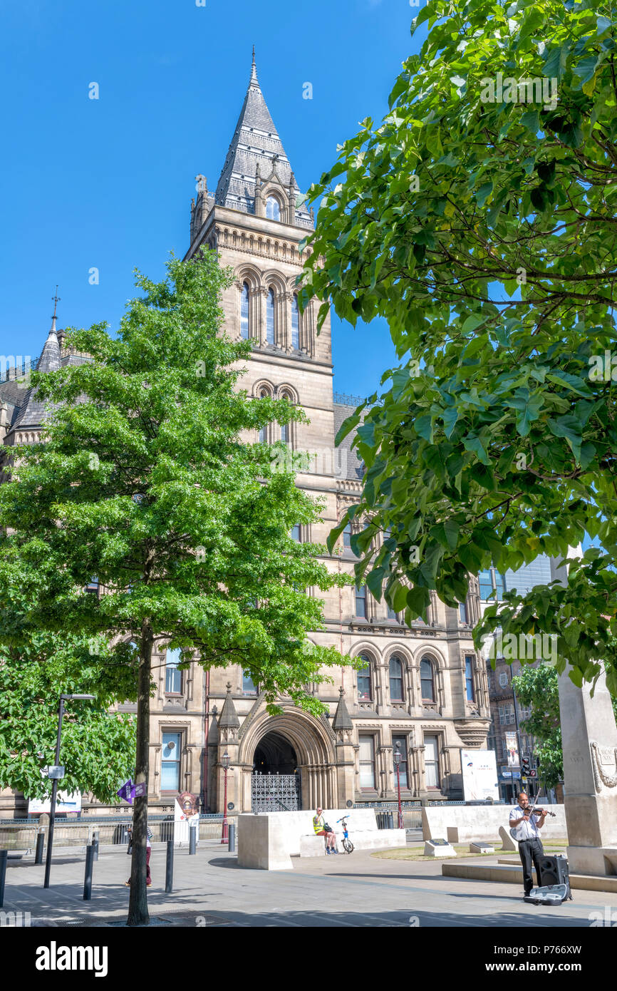 Part of Manchester Town Hall nestled amongst trees on the edge of St Peters Square, Manchester, UK - Stock Image