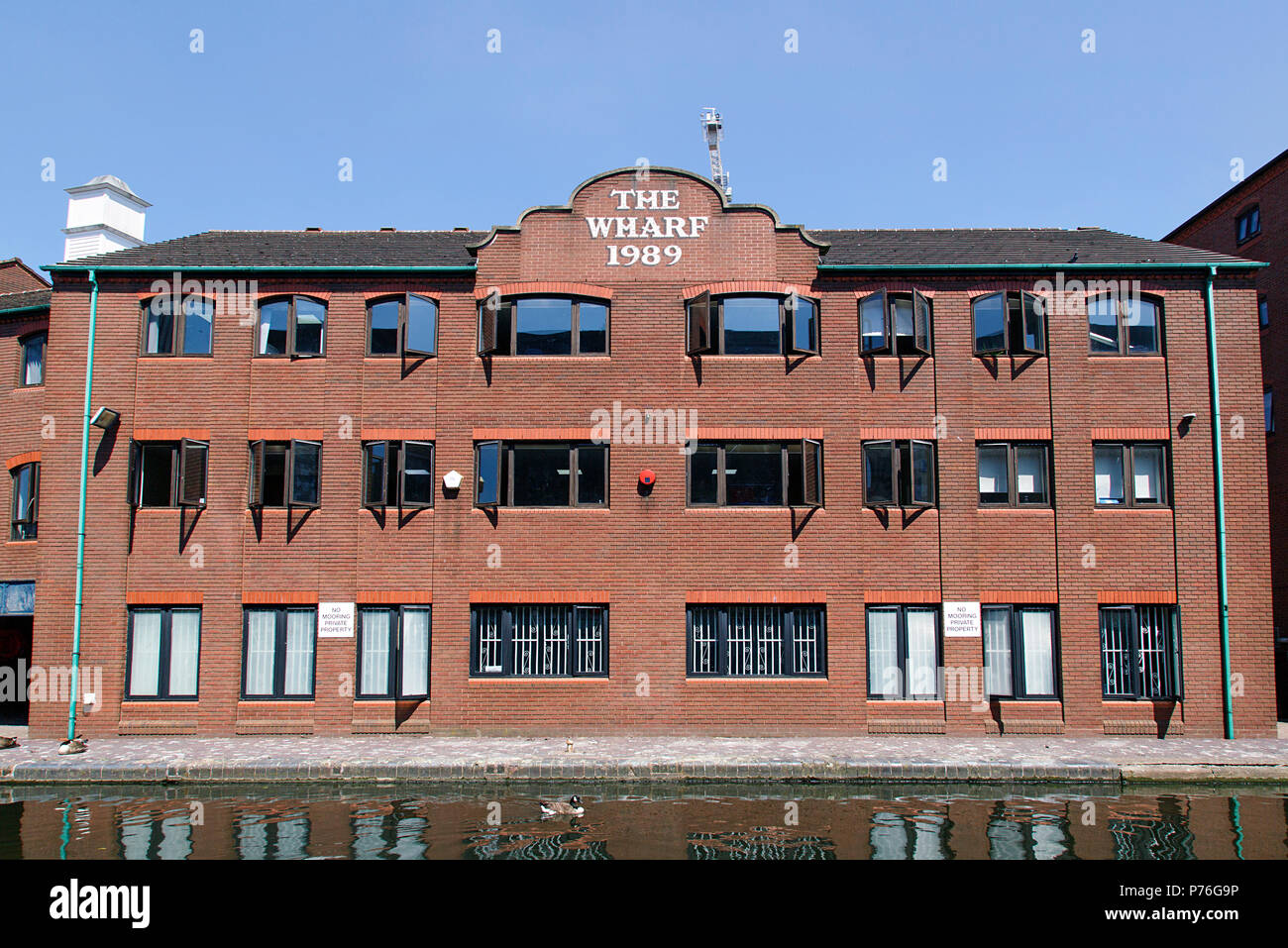 Birmingham, UK: June 29, 2018: Residential apartment building on Gas Street along the restored canal system. - Stock Image