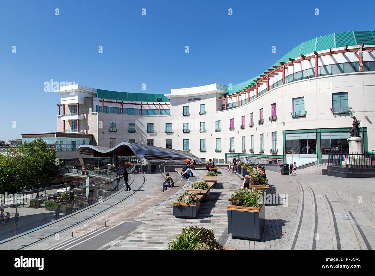 Birmingham, UK: June 29, 2018: The Bullring Shopping Centre - Birmingham. People shopping in the pedestrianised zone. Summer blue sky background. - Stock Image