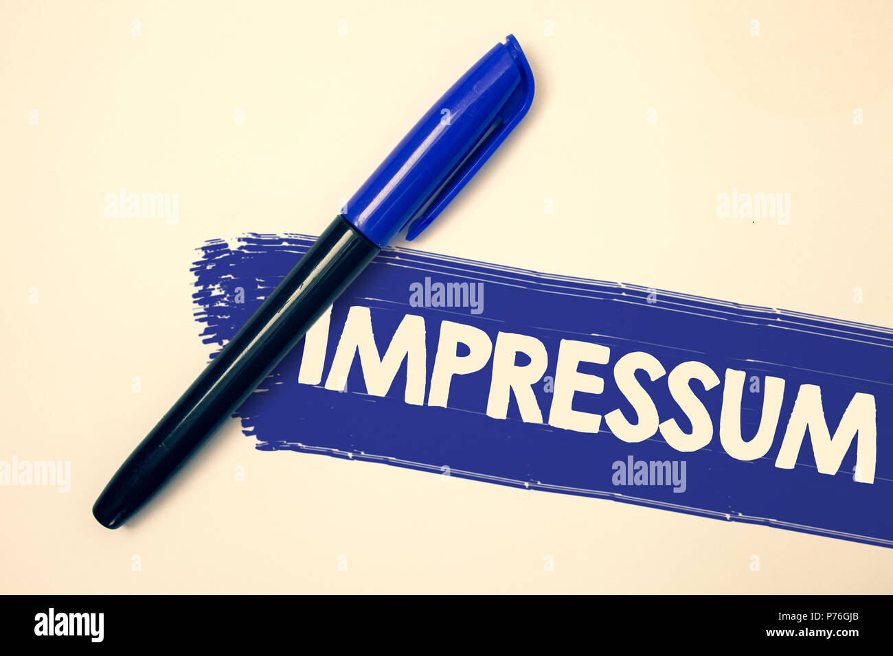 Word writing text Impressum. Business concept for Impressed Engraved Imprint German statement ownership authorship Ideas messages faded painting blue  - Stock Image