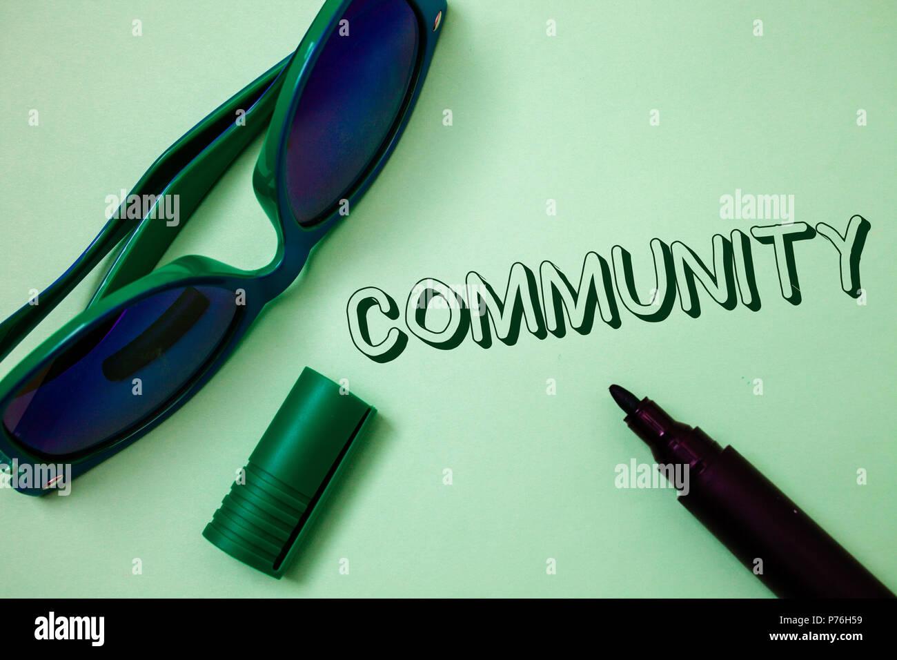 Writing note showing  Community. Business photo showcasing Neighborhood Association State Affiliation Alliance Unity Group Ideas messages white backgr - Stock Image