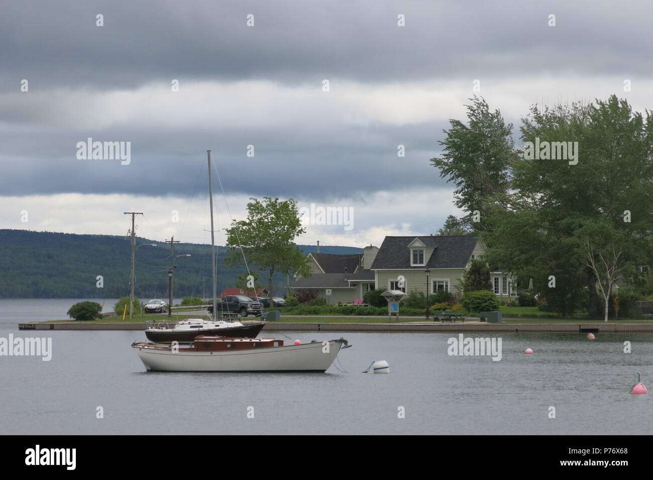 A view overlooking the harbour and lakefront at Baddeck, on the northern shores of Bras d'Or Lake, Nova Scotia, Canada. - Stock Image