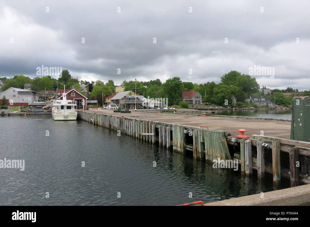 A view along the wharf at Baddeck on the shores of Bras d'Or Lake, Nova Scotia, Canada - Stock Image
