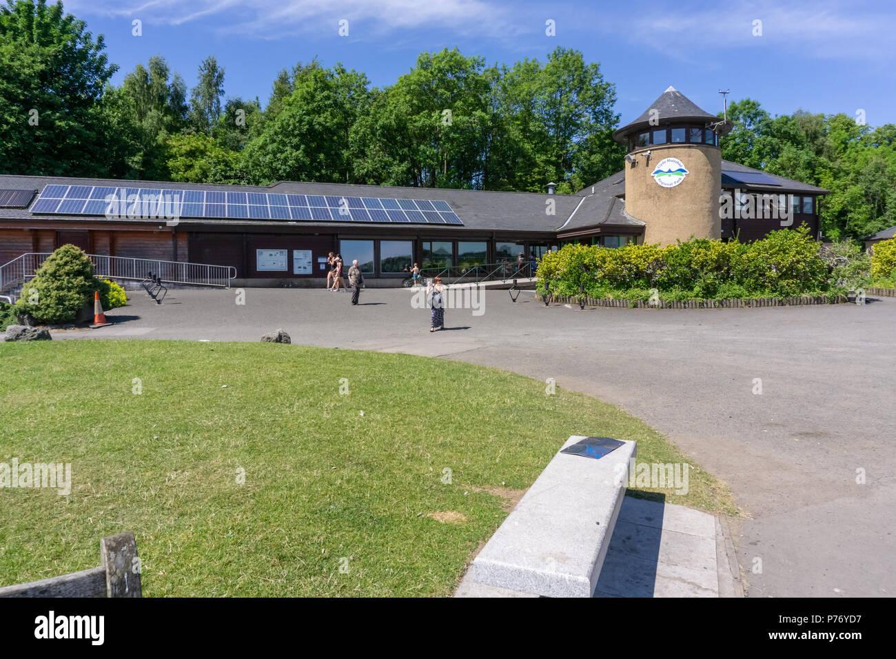 Lochwinnoch, Scotland, UK - July 01, 2018: Clyde Muirshiel Castle Semple visitors centre in Lochwinnoch taking advantage of the unusual hot weather in - Stock Image