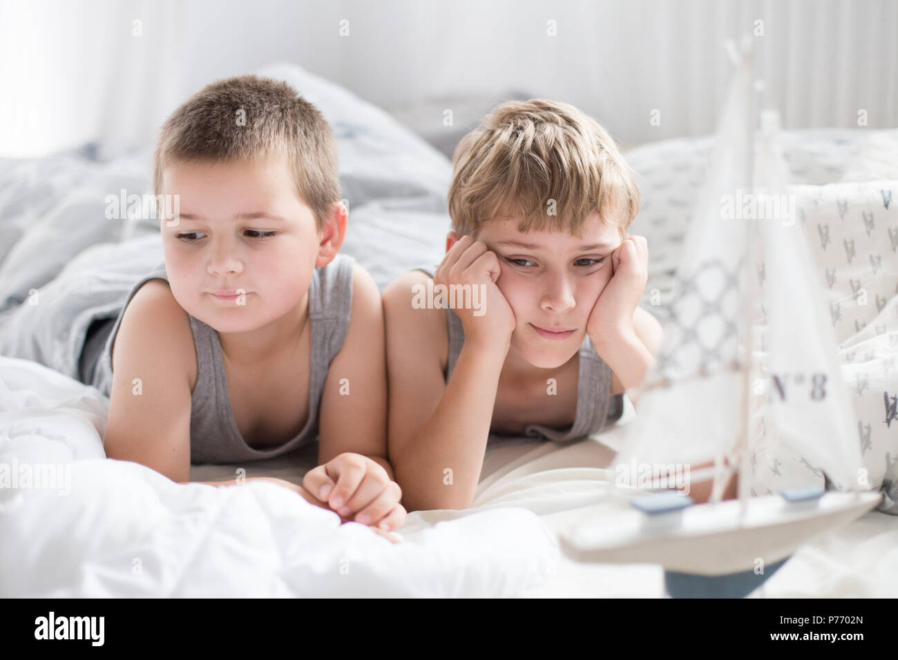 Brothers - a lazy morning in bed, bedding. Fun and rest, relax, lazy Sunday - Stock Image