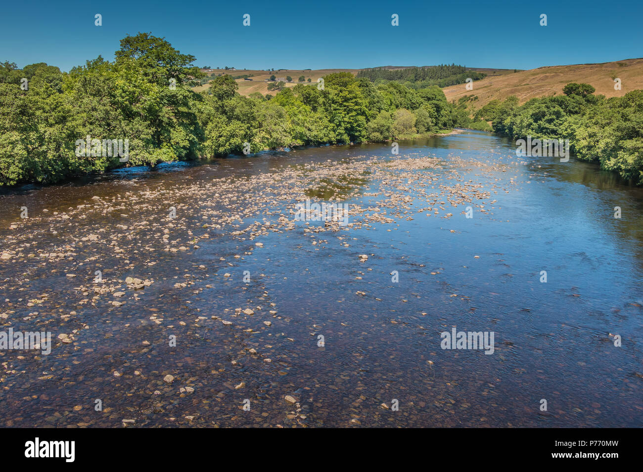 North Pennines landscape, the river Tees upstream from Beckstones Wath footbridge, Mickleton, Teesdale, UK in summer sunshine and a clear blue sky - Stock Image