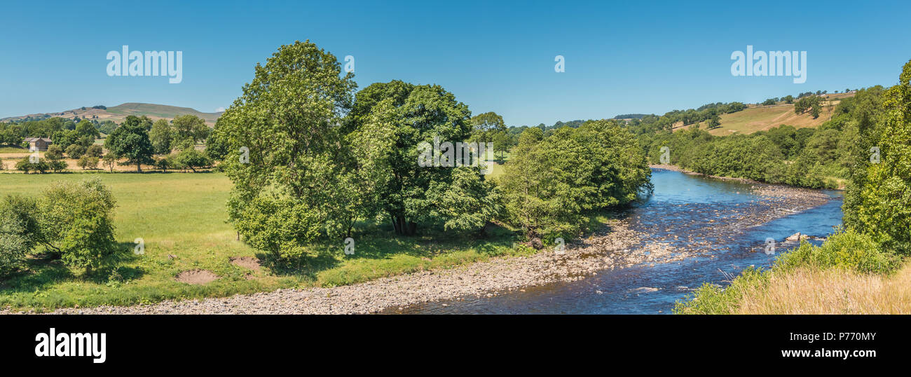North Pennines panoramic landscape, the river Tees upstream from Beckstones Wath footbridge, Mickleton, Teesdale, UK in sunshine and a clear blue sky - Stock Image