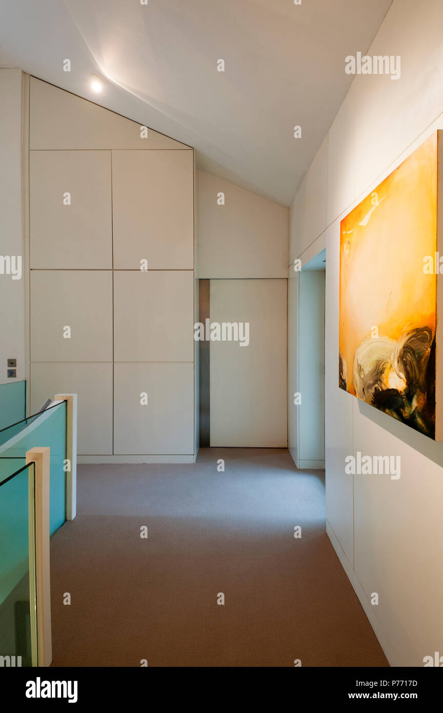 Storage and painting in hallway - Stock Image