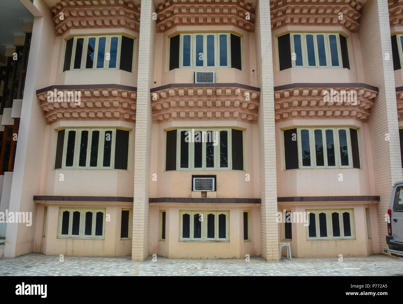 Bodhgaya, India - July 9, 2015. A modern building in Bodhgaya, India. Bodhgaya is the most revered of all Buddhist sacred sites. - Stock Image