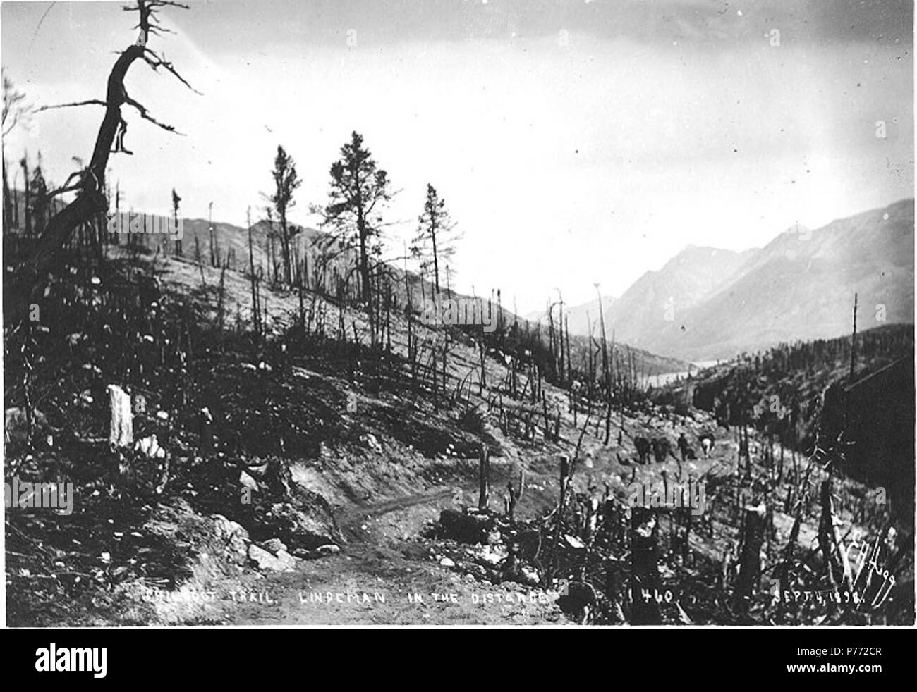 . English: Chilkoot Trail showing Lindeman Lake in the distance, British Columbia, September 4, 1898 . English: Caption on image: 'Chilkoot Trail. Lindeman in the distance Sept 4, 1898' Klondike Gold Rush. Subjects (LCTGM): Lindeman Lake (B.C.); Lakes & ponds--British Columbia Subjects (LCSH): Chilkoot Trail; Trails--British Columbia  . 1898 2 Chilkoot Trail showing Lindeman Lake in the distance, British Columbia, September 4, 1898 (HEGG 440) - Stock Image