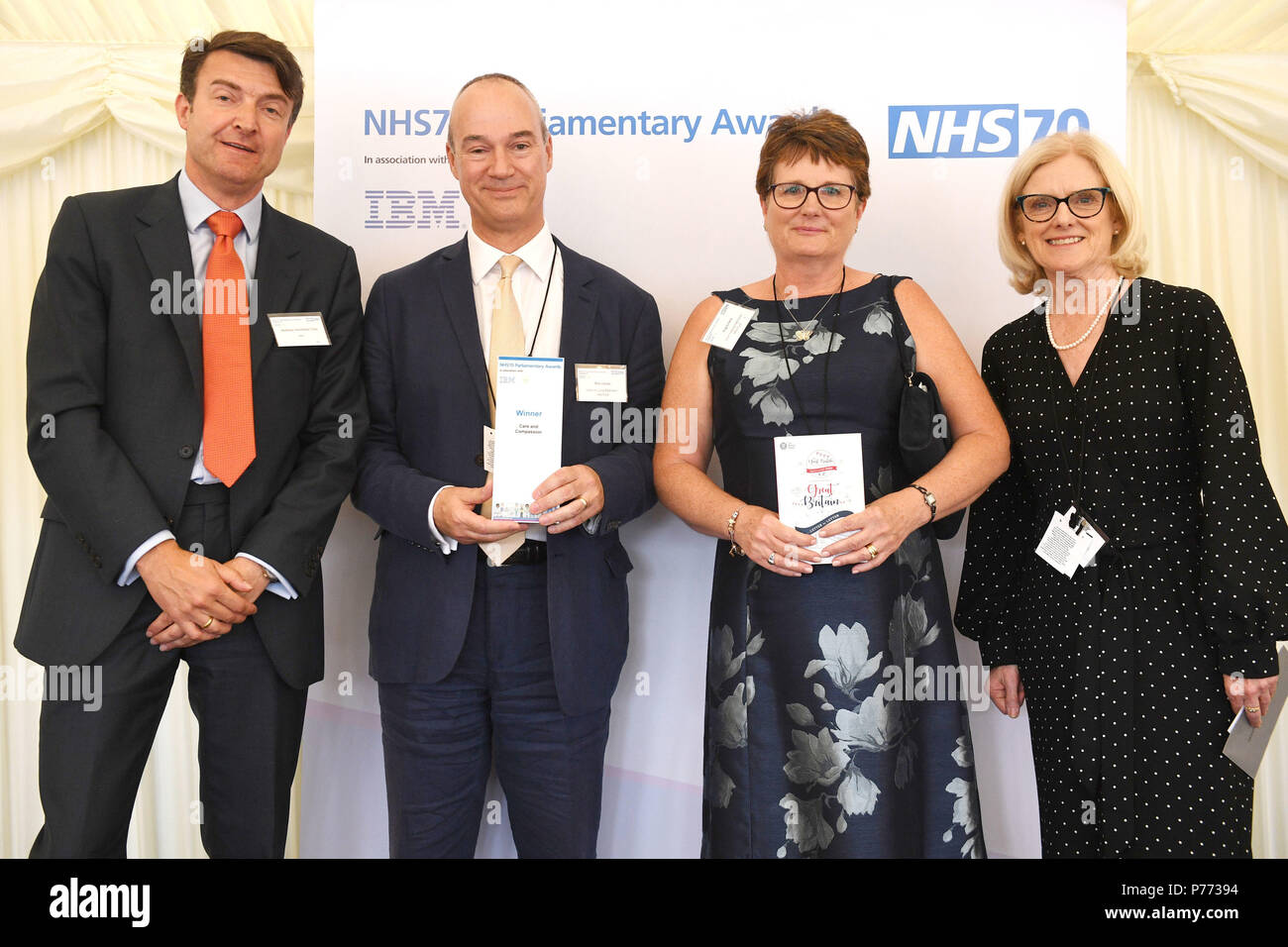 Angela Fenn (second right) and Nick Craver (second left) are given the Care and Compassion Award from Andreas Haimbock -Tichy (left) and Janet Davies (right) during the NHS70 parliamentary awards for the 70th anniversary of the NHS at the House of Commons in Westminster, London. - Stock Image