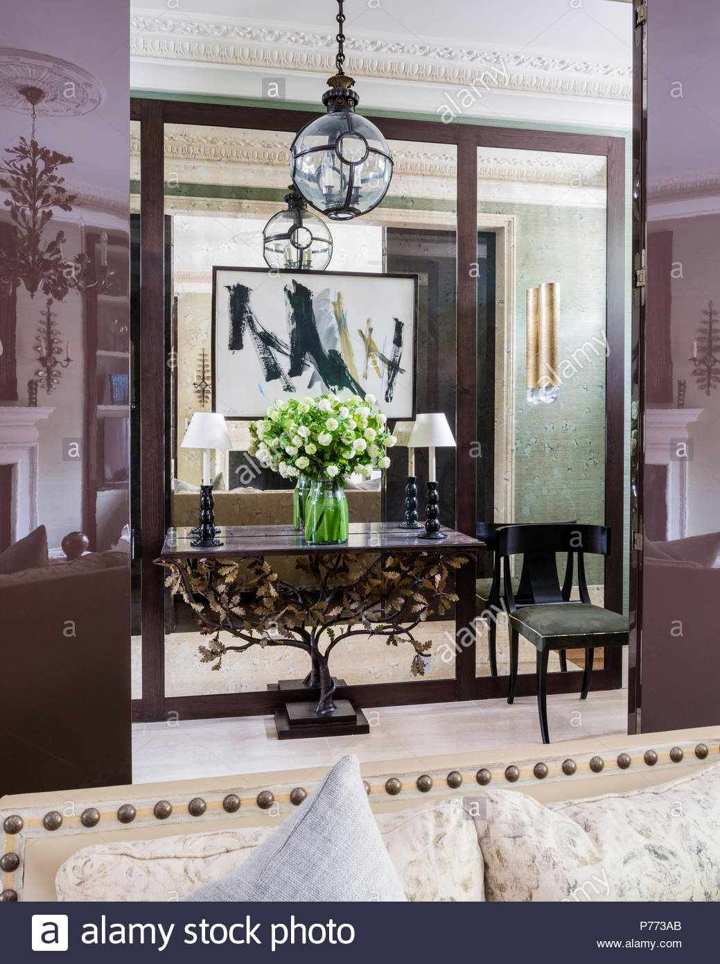 Large Glass Pendant Hangs Above Oak Leaf Table By Charles Saunders In  Hallway With Mirrored Wall.
