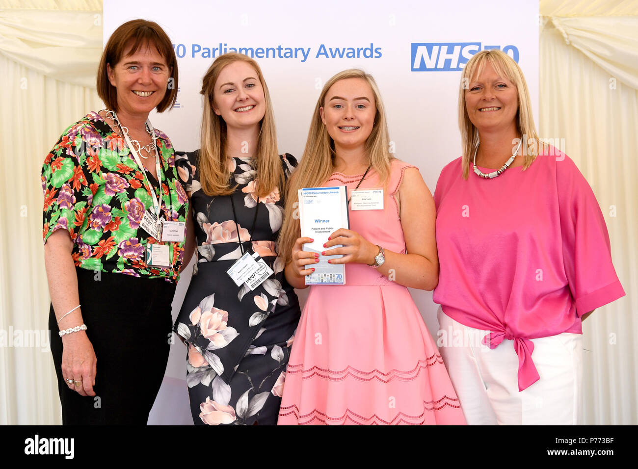 Rebecca Booth (second left) and Alex Sagar (second right) of Victoria's Voice Youth Forum in Blackpool are given the Patient and Public Involvement Award from Kate Smith (right) and Rachel Power (left) during the NHS70 parliamentary awards for the 70th anniversary of the NHS at the House of Commons in Westminster, London. - Stock Image