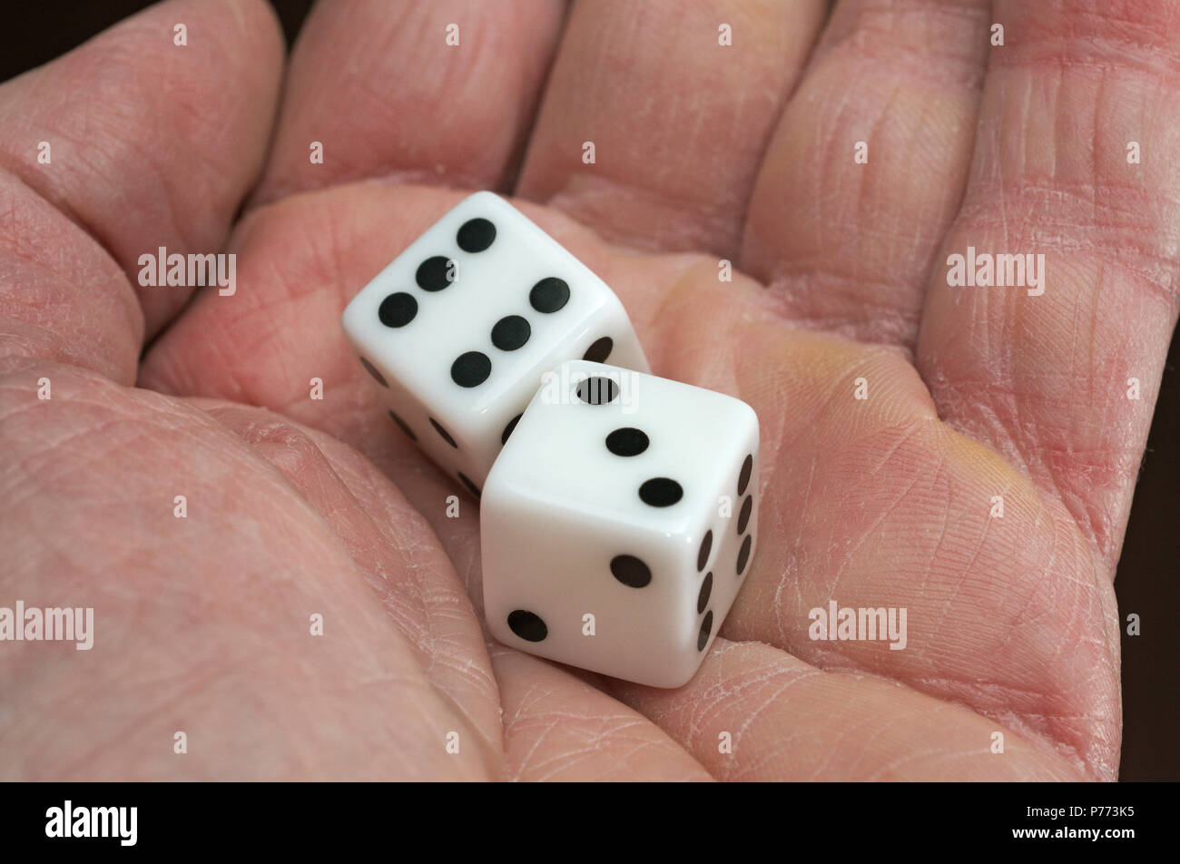 hand holding pair of dice - Stock Image