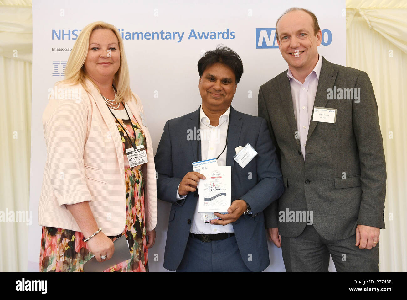 Professor Shafi Ahmed (centre) receives his Future NHS Award from Kerry Eldridge and Neil Churchill during the NHS70 parliamentary awards for the 70th anniversary of the NHS at the House of Commons in Westminster, London. - Stock Image