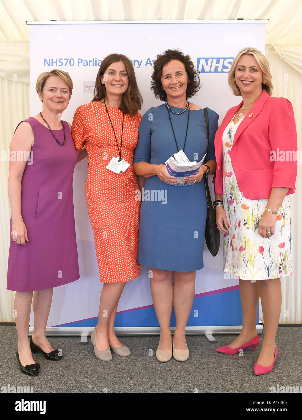 Susan Blackmore of Cumbria Health On Call receives her Excellence in Primary Care Award from Dr Helen Stokes Lampard (first right) and Baroness Dido Harding (first left) during the NHS70 parliamentary awards for the 70th anniversary of the NHS at the House of Commons in Westminster, London. - Stock Image