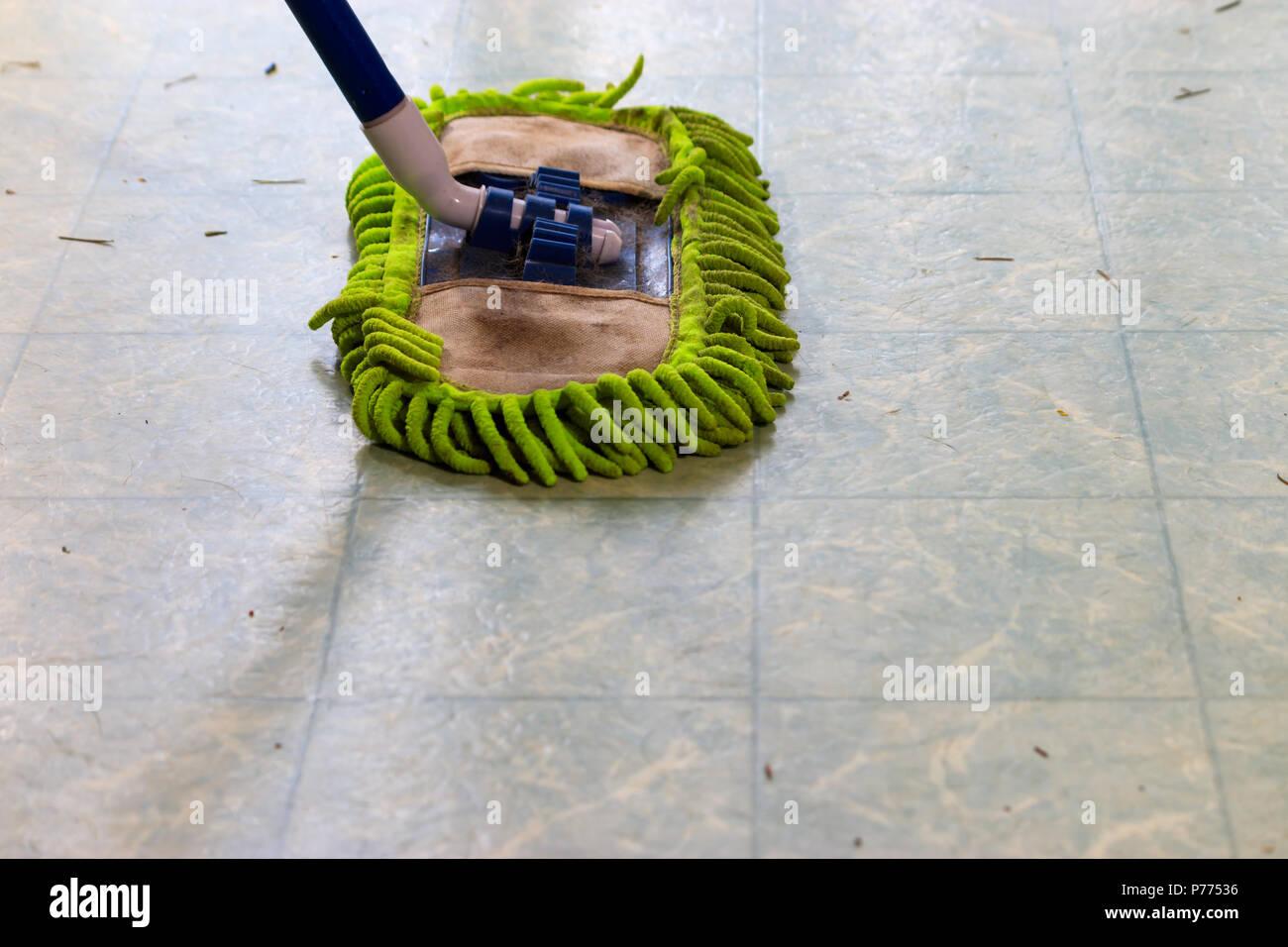 dust mop on laminate - Stock Image
