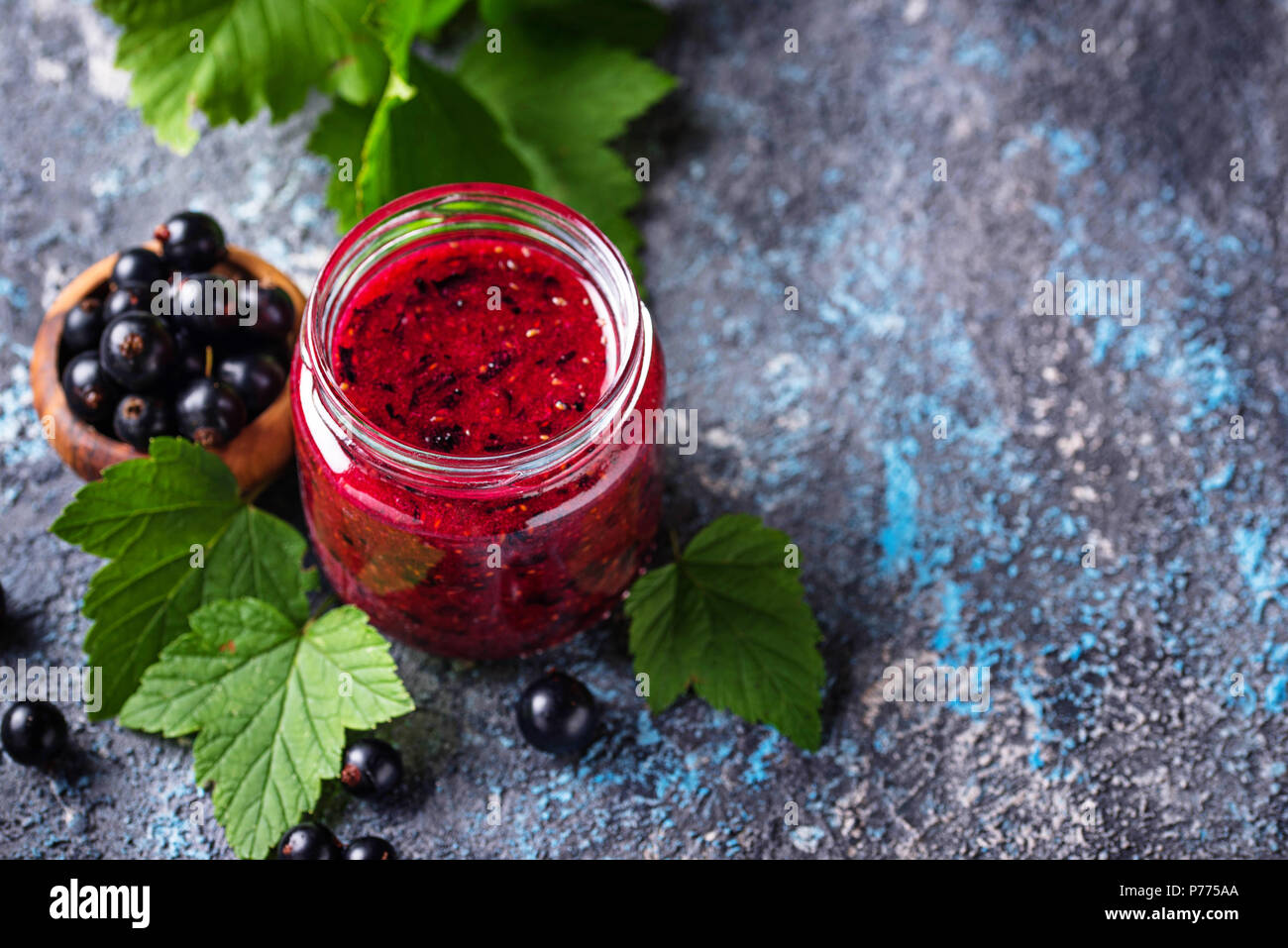 Black currant jam in jar - Stock Image