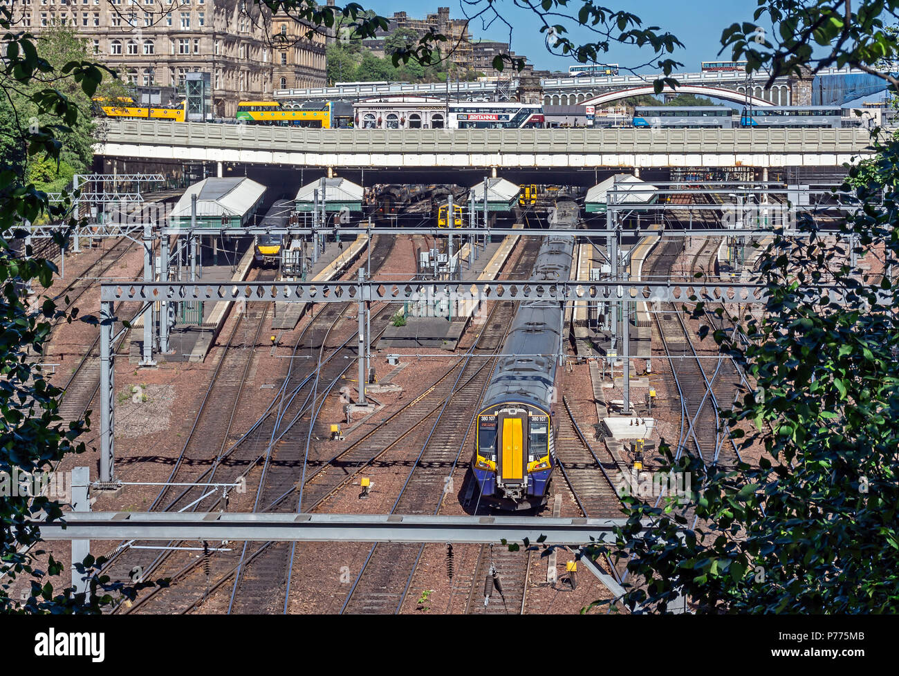 Electric Multiple Unit Class 380 arriving at Waverley Station in Edinburgh city Scotland UK from Glasgow - Stock Image