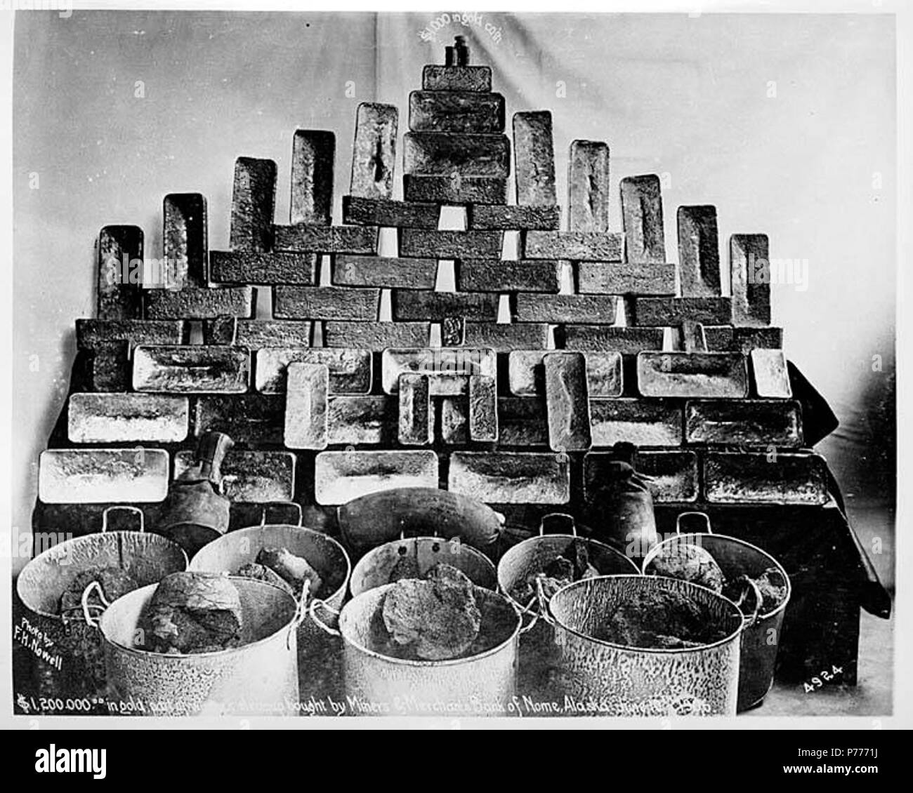 English: Gold bricks and buckets of gold ore, Nome, 1906   English