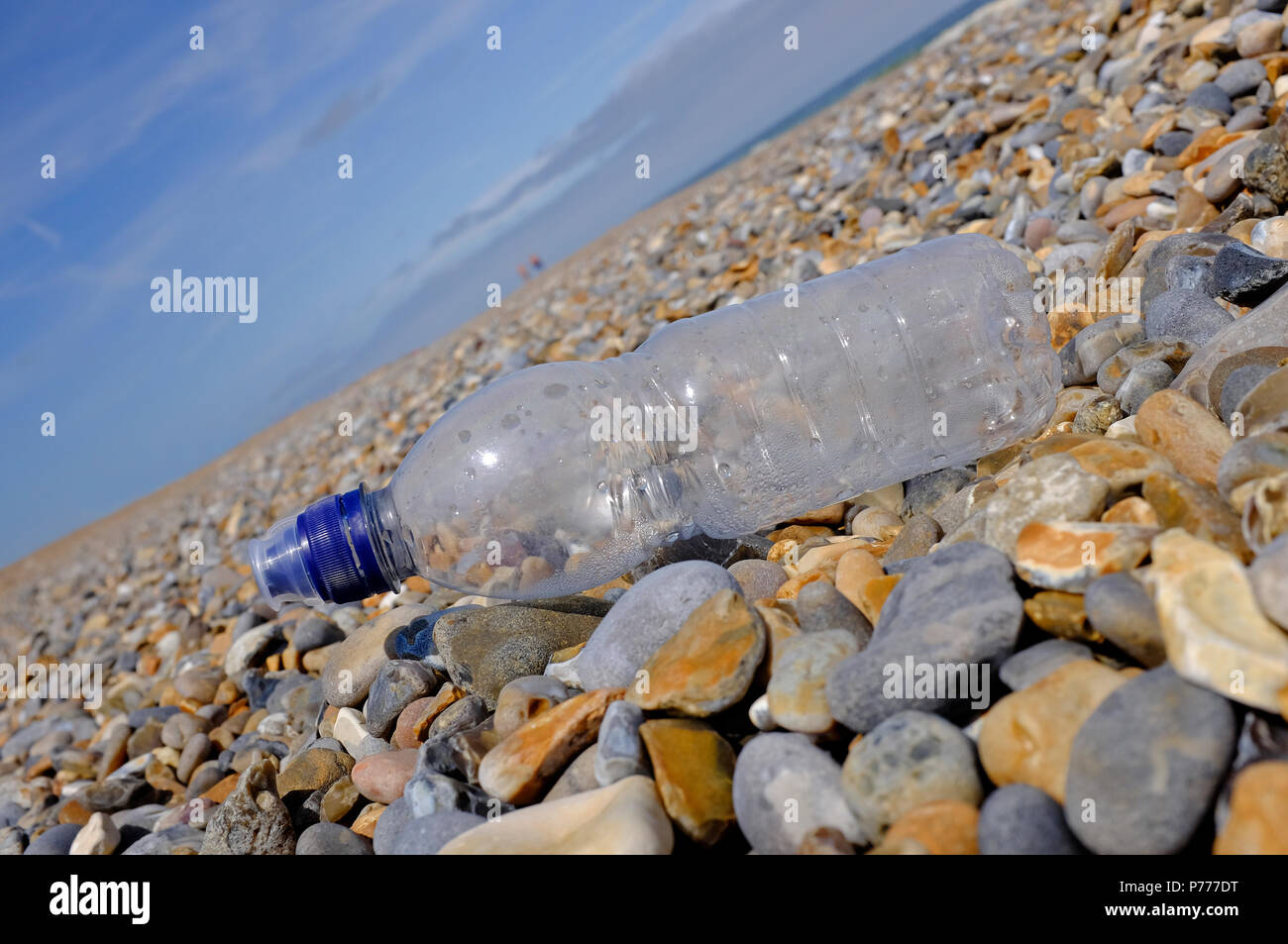 plastic bottle on shingle beach, cley, north norfolk, england - Stock Image