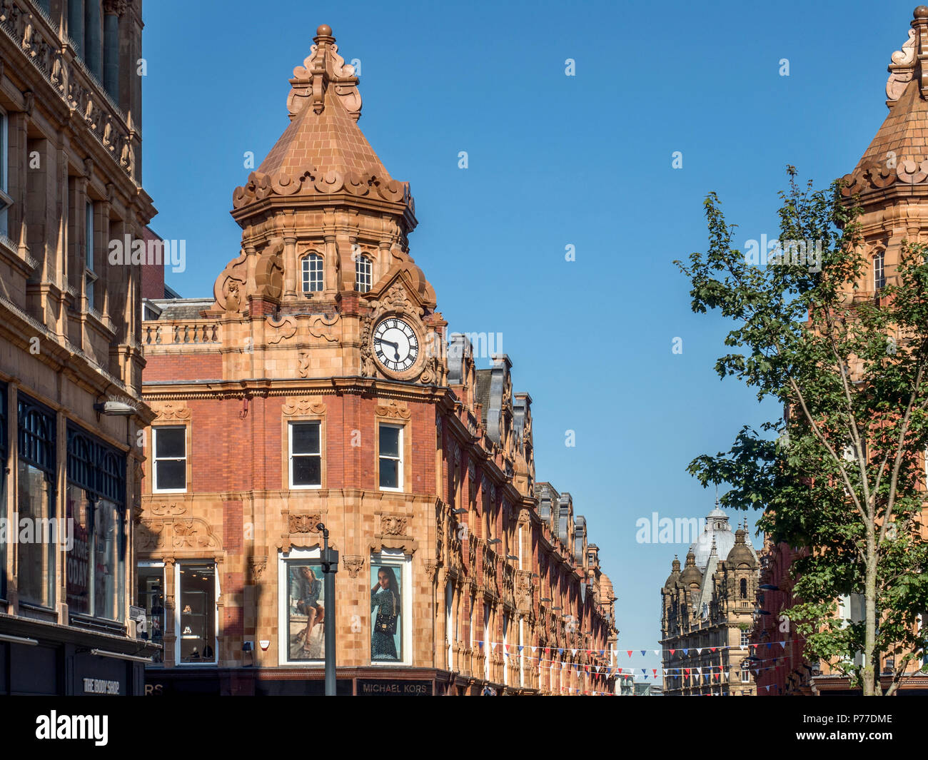 Clock on the corner of King Edward Street and Briggate from Albion Place Leeds West Yorkshire England - Stock Image