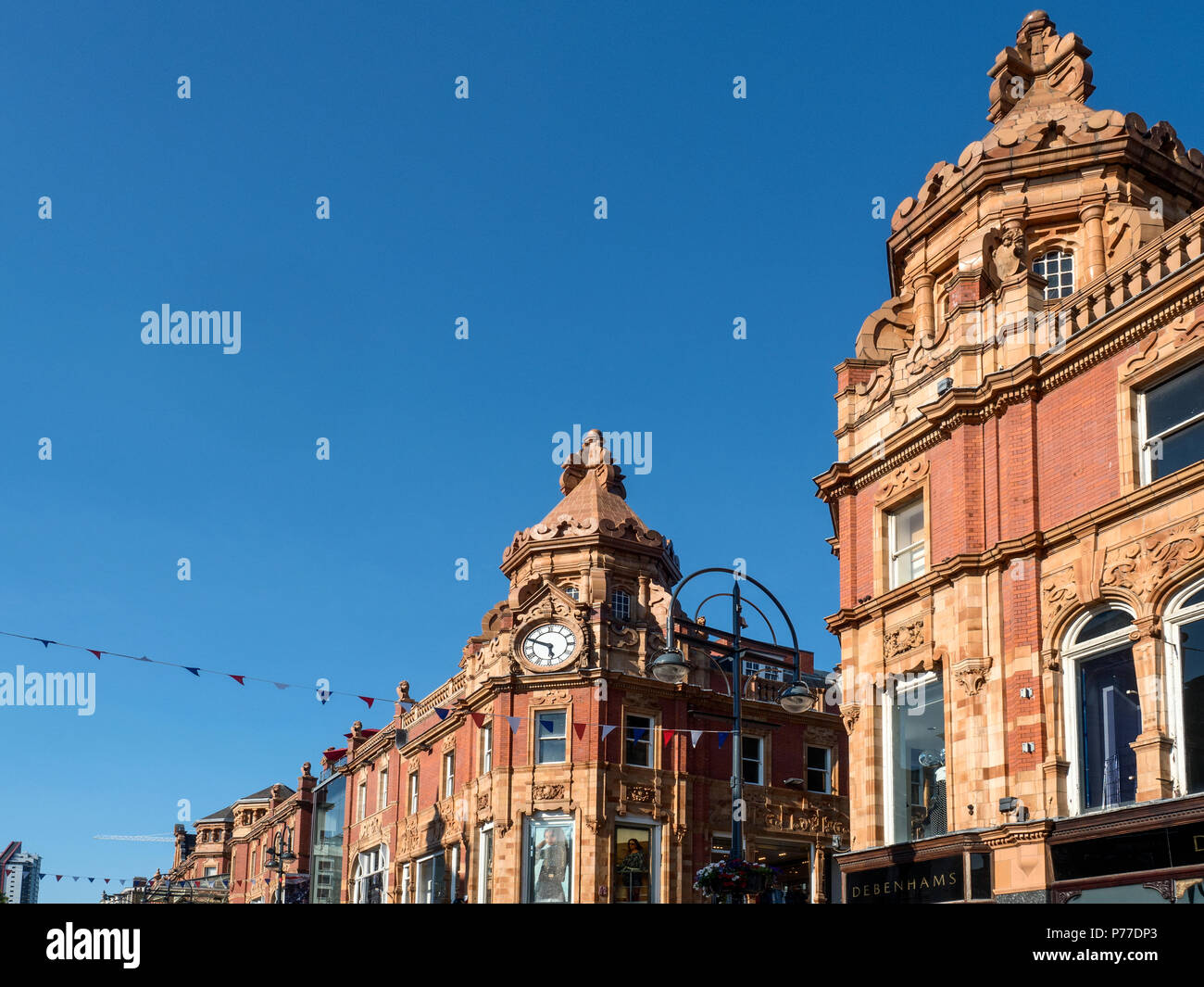 Clock on the corner of King Edward Street and Briggate in the Victoria Quarter Leeds West Yorkshire England - Stock Image