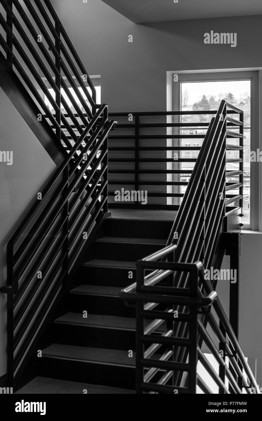 Stair well with metal railing and steps leading up to nest floor - Stock Image
