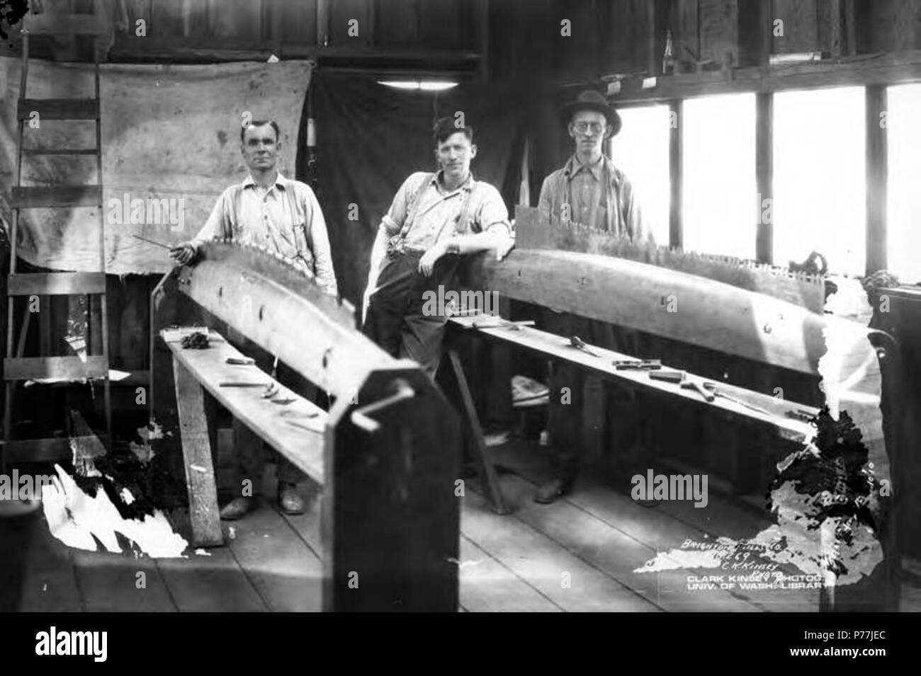 . English: Saw filers working on saws, Brighton Mills Company, Brighton, ca. 1922 . English: Caption on image: Brighton Mills Co, No. 269 PH Coll 516.248 Brighton was founded in 1910 and was named after the seaside resort in England. The Brighton Mills Company was founded in 1911 by the Watts Brothers of Bay City. The mill was closed in 1926. Subjects (LCSH): xyz  . circa 1922 11 Saw filers working on saws, Brighton Mills Company, Brighton, ca 1922 (KINSEY 2148) Stock Photo