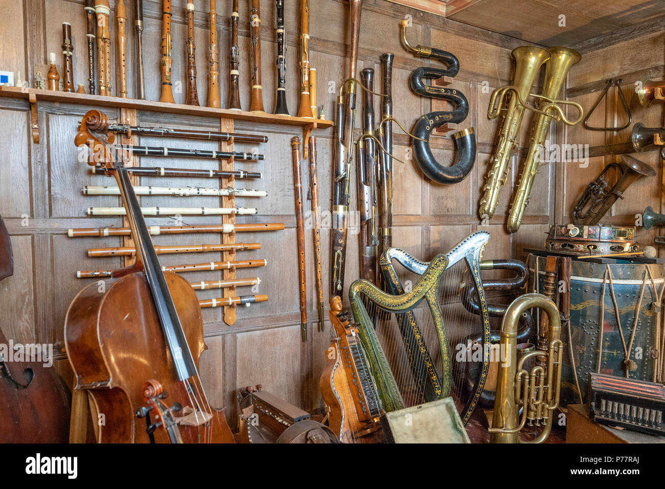 Old musical instruments on display at Snowshill Manor in the Cotswold village of Snowshill, Gloucestershire UK - Stock Image