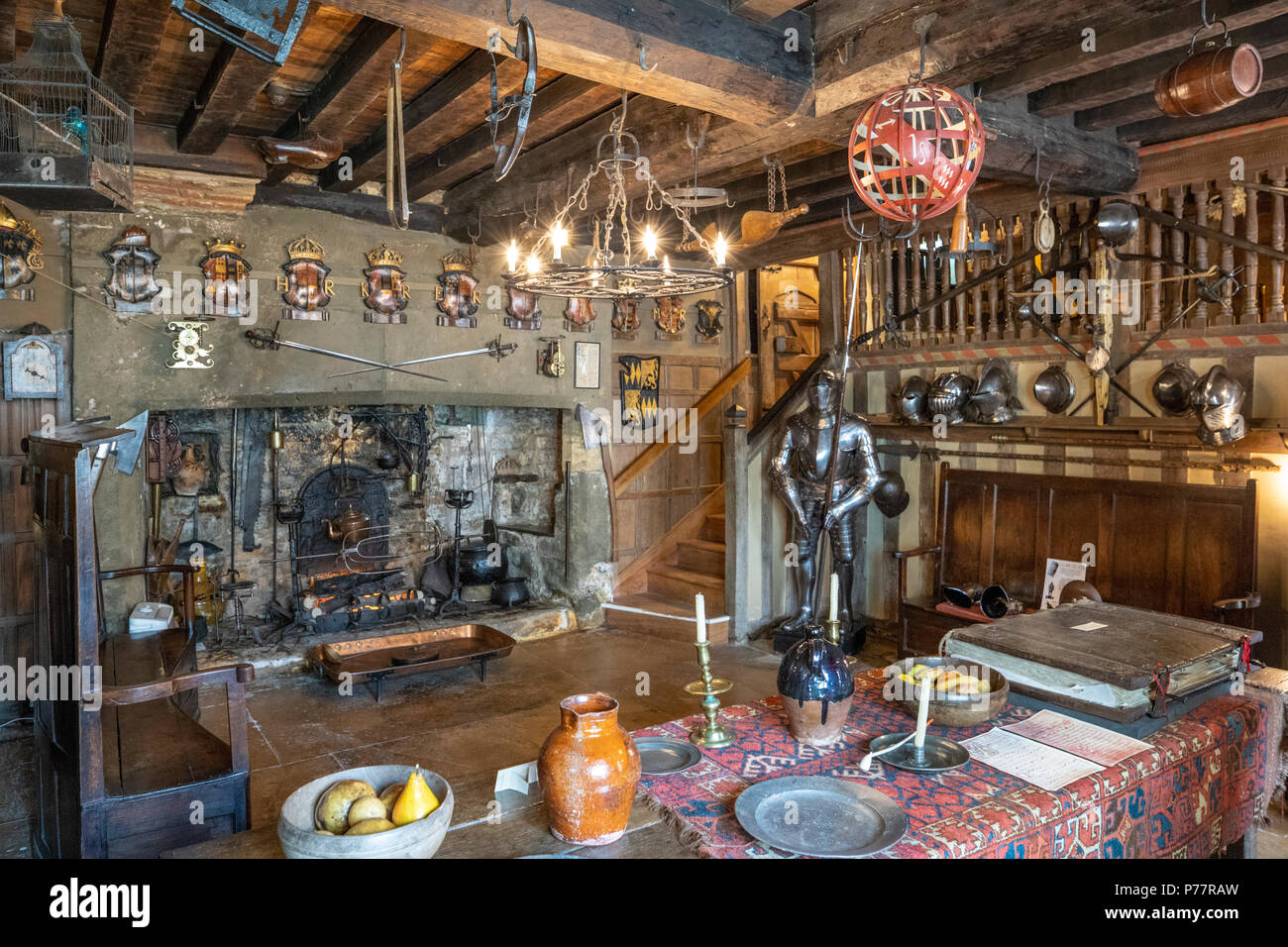 The kitchen at Snowshill Manor in the Cotswold village of Snowshill, Gloucestershire UK Stock Photo