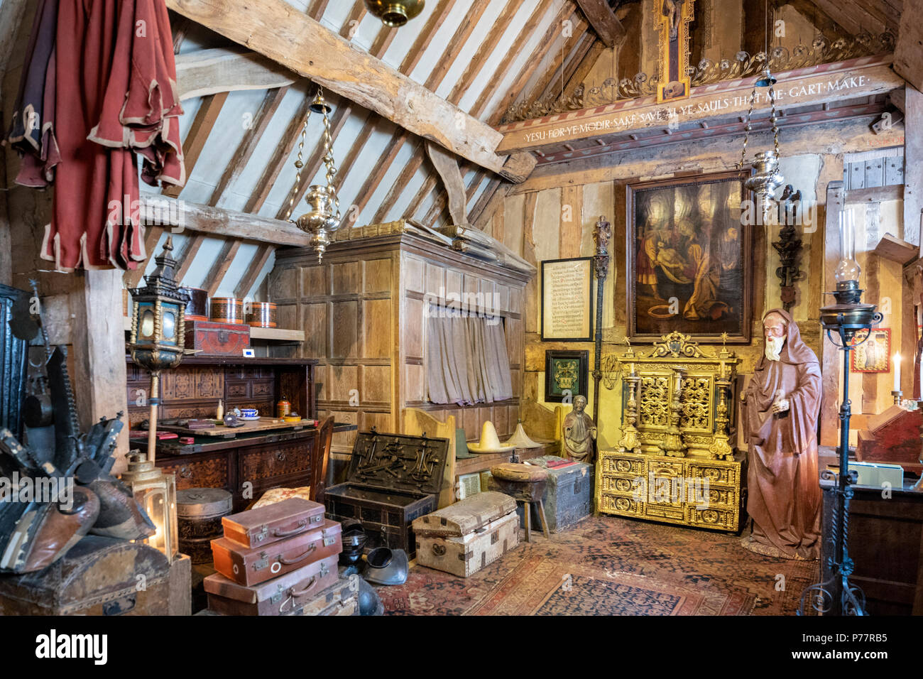 Charles Wades bedroom in the Priests House at Snowshill Manor in the Cotswold village of Snowshill, Gloucestershire UK Stock Photo