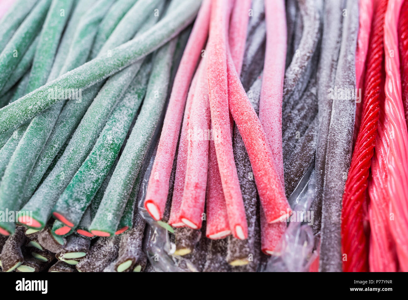 Wonderful candy sticks in any color and appearance - Stock Image