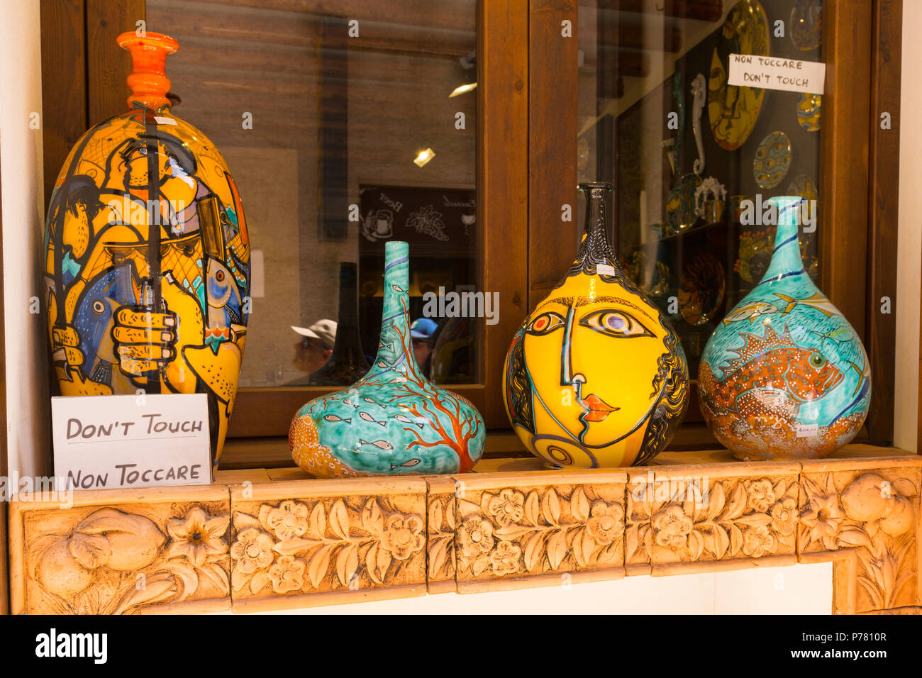 Italy Sicily medieval walled town Erice on Monte San Giuliana cult Venus Erycina decorative colourful urns vases display shop store window - Stock Image