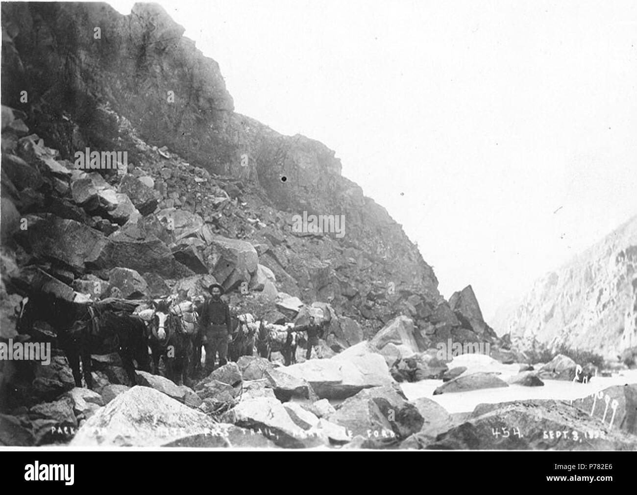. English: Packtrain on White Pass Trail near the ford crossing the Skagway River, Alaska, September 3, 1898 . English: Probably close to the summit of White Pass . Caption on image: 'Packtrain on White Pass Trail. Near the Ford. Sept. 3, 1898' . Klondike Gold Rush Subjects (LCTGM): Pack animals--Alaska; Horses--Alaska Subjects (LCSH): Mountain passes--Alaska; White Pass Trail; Trails--Alaska  . 1898 10 Packtrain on White Pass Trail near the ford crossing the Skagway River, Alaska, September 3, 1898 (HEGG 488) - Stock Image
