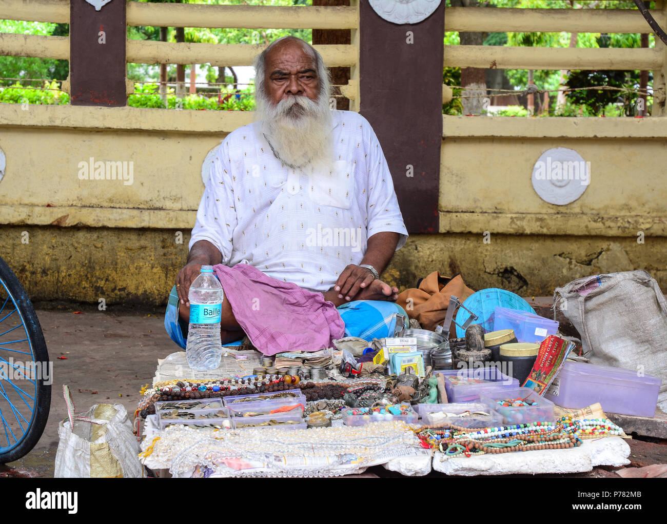 Bodhgaya, India - July 9, 2015. Vendor at street market in Bodhgaya, India. Bodhgaya is the most revered of all Buddhist sacred sites. - Stock Image